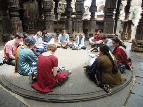 Sanskrit students reading an inscription