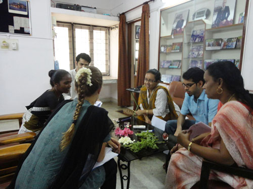 Tamil participants interacting with a monolingual guest