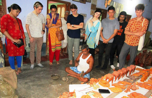 With a terracotta craft artist