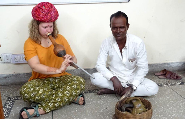 Student showing her skill during snake charmer class